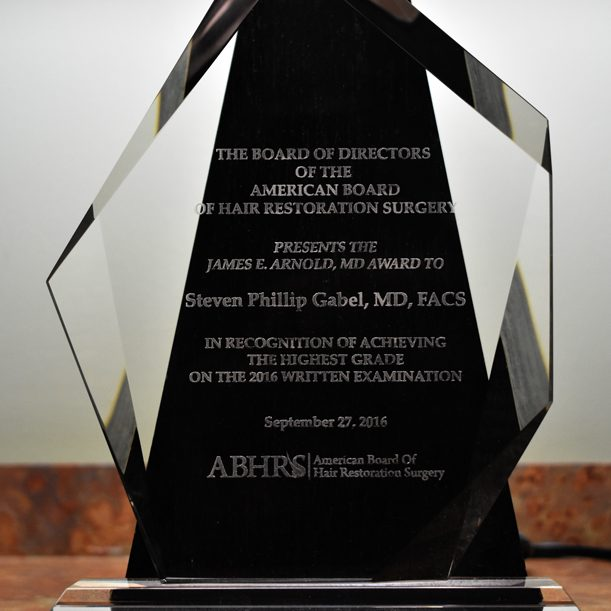 Close-up of 2017 James E. Arnold, MD award for highest grade on 2016 written exam, winner Steven Gabel